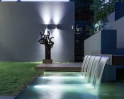 LED Underwater Pool Lights and Pond Lights - Triple Lens - 180W: Shown Installed In Water Feature In White.