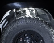 Waterproof Off Road LED Rock Light  - LED Rock Lights: Shown Installed Over Front Wheel In White.