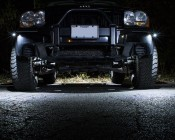 Waterproof Off Road LED Rock Light Kit - 8 LED Rock Lights: Front View Of Lights Installed On Jeep In White.