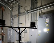 Portable LED Work Light Kit w/ Telescoping Tripod - 64W - 7,000 Lumens: Illuminating Electrical Room Back View