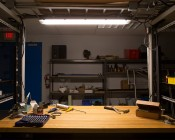 T8 LED Vapor Proof Light Fixture for 2 LED T8 Tubes - Industrial LED Light - 4' Long: Shown Installed Over Work Bench With Warm White T8 Tubes (Sold Separately).