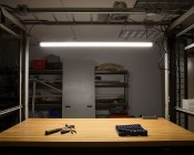 50W Linkable Linear LED Light Fixture - Industrial LED Light - 5' Long: Shown Installed With Hanging Kit (Sold Separately) Over Work Bench In Natural White.