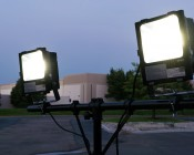 Work Light Tripod Stand w/ Tubular T-Bar: Shown With High Voltage Flood Lights Mounted (FLC2-x50W Sold Separately).