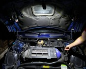 WORKBRITE 2 LED Work Light - NEBO Flashlight: Shown Illuminating Under Car Hood.