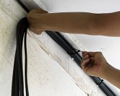 Black Cable Ties - 10 Pack: Tying Power Cables Along Edge of Basement Wall