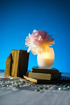 wedding center pieces with LEDs and books